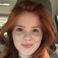 Isabel Oliver Marcus in a car.[2]