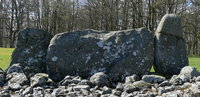 Massive recumbent stone with flanking pillars