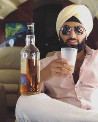 Raunaq Singh on a private plane having a drink